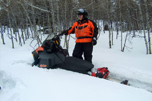 How to free your snowmobile from a snow bank