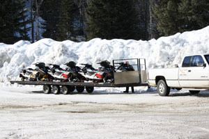 Transporting your snowmobile using a flat bed trailer