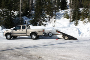 Transporting your snowmobile using a tilt bed trailer