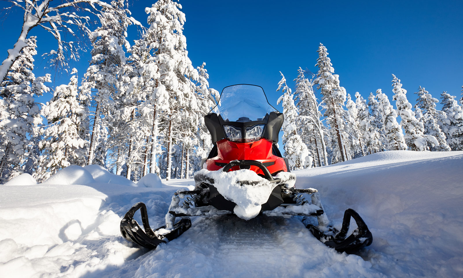 Snowmobile in newly fallen snow