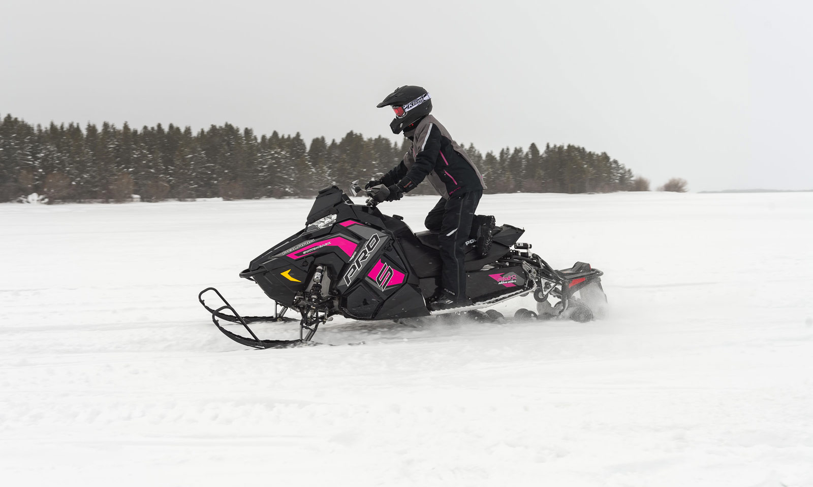 Snowmobiler riding on ice