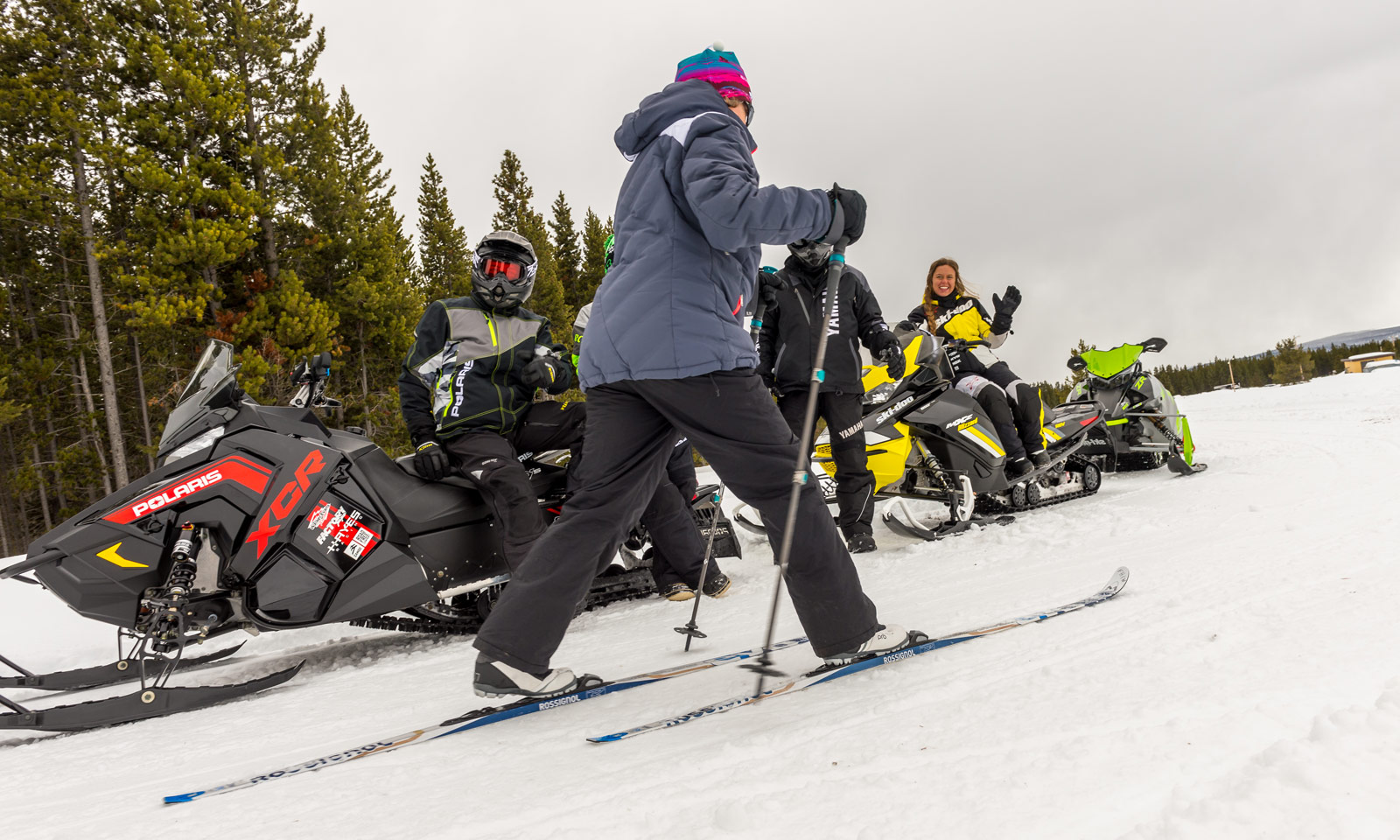Snowmobilers encountering a cross-country skier